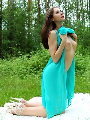 Assoli looks ravishing in her teal summer dress on this lovely summer afternoon. The warmth of the summer day causes our lovely maiden to become restl