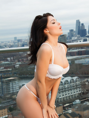 Gorgeous Ava Delush shows off her curves outside in her white bra and panties.