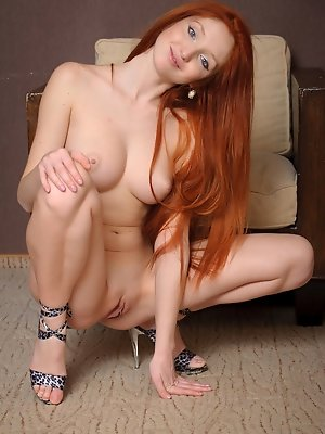 Nalia showcases her creamy smooth skin, shapely body, delectable smooth bits, and her large, luscious breasts.